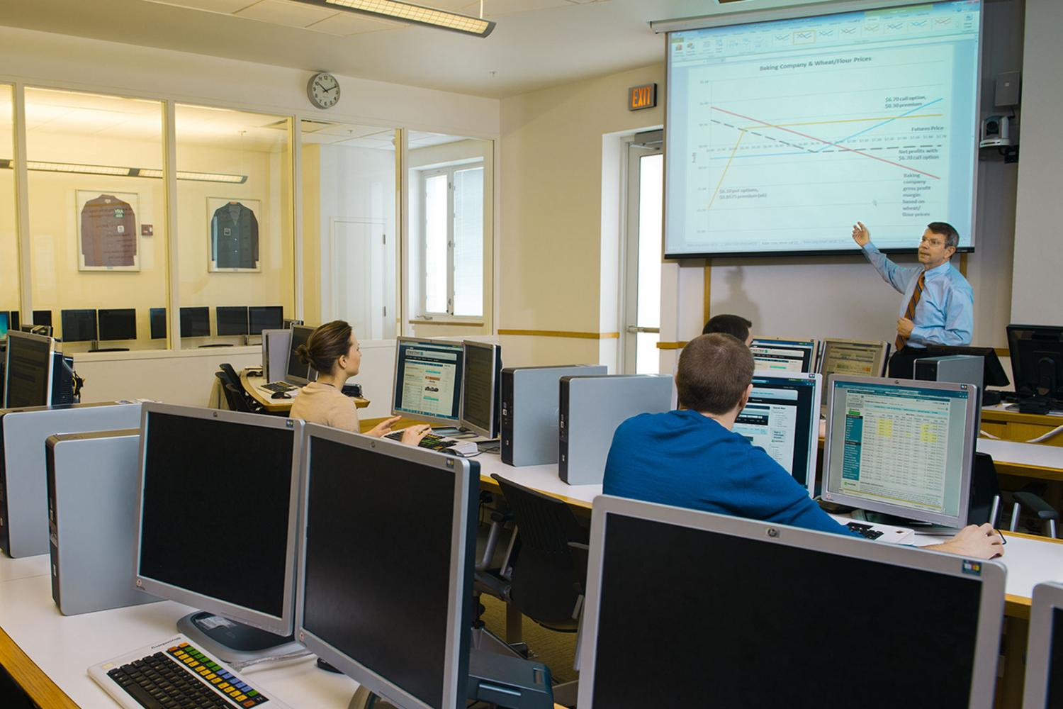 Photo of students and faculty in a computer classroom.